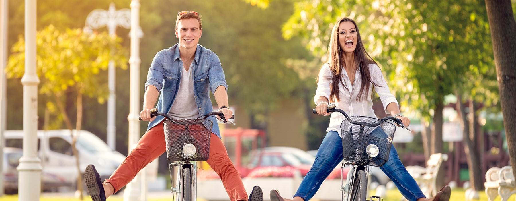 couple riding bikes in a park